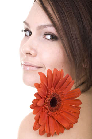 Beautiful young woman in spa with flower. Isolated. Stock Photo - 5680293