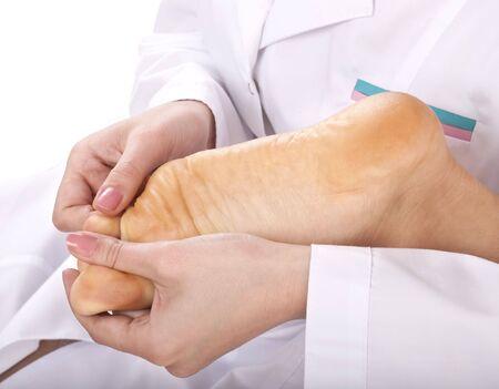 Beautician do medicine  massage leg. First aid. Stock Photo - 5688386