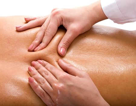 Massage of female back. Spa resort.
