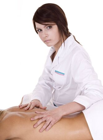 Professional masseur does massage in spa salon. Isolated. Stock Photo - 5680224