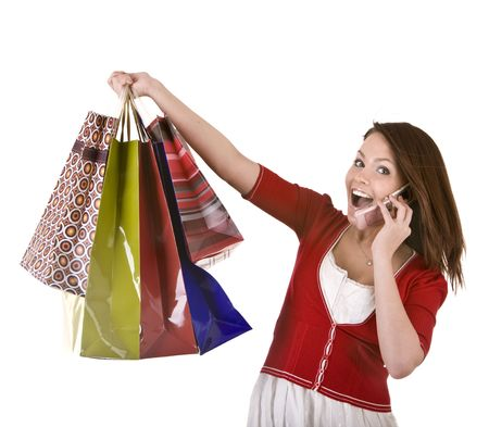 Young girl with shopping bag and mobile  telephone. Isolated. photo