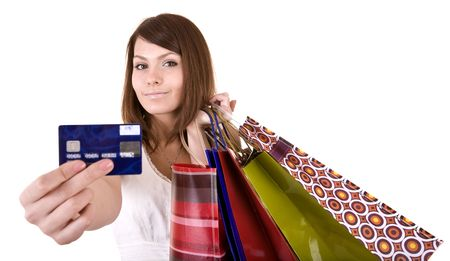 Girl with bag and credit card. Isolated. photo