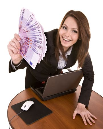 Businesswomen with group of money and laptop. Isolated. Stock Photo - 5680237
