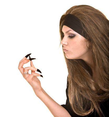 witch in black costume and long hair with claw finger.Isolated.    photo