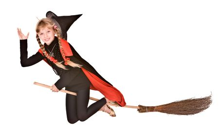 Child girl in costume Halloween witch in black dress and hat fly on broom.Isolated. photo