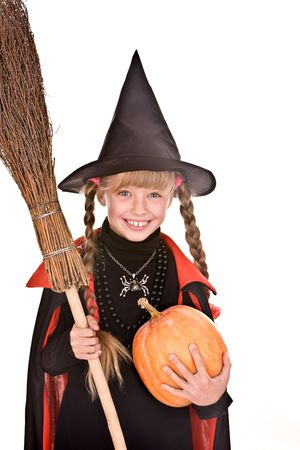Child girl  Halloween witch  in black hat and dress with pumpkin, broom.Isolated. photo