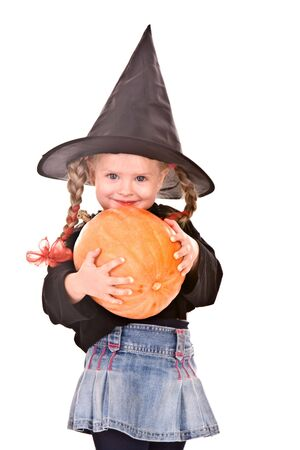 Child girl  Halloween witch  in black hat and costume with pumpkin.Isolated. photo