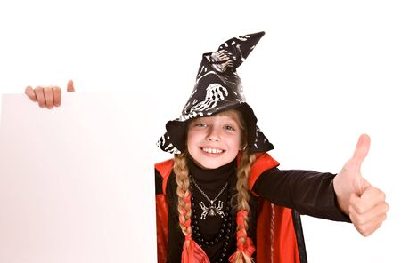 Halloween witch girl child with banner and thumb.  Isolated. photo