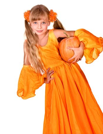 Girl in orange long dress with pumpkin  at thanksgiving.Isolated. photo