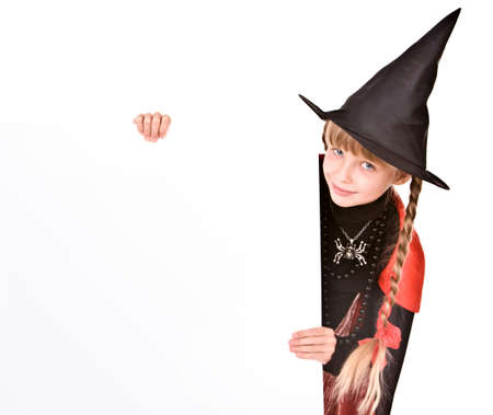 Child girl in Halloween witch costume with banner. Isolated. Stock Photo - 5680118