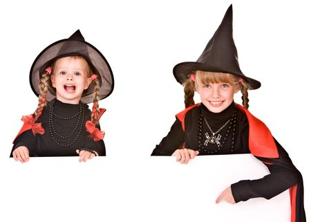 Child girl in Halloween witch costume with banner. Isolated. photo