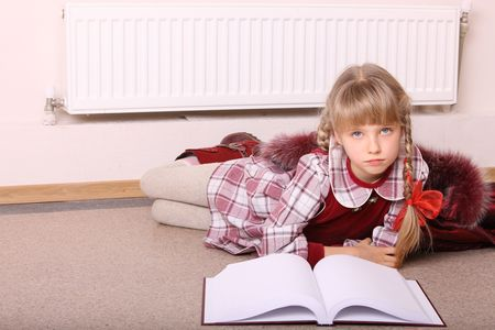 one girl only: Girl lie near radiator with book. Cold crisis.