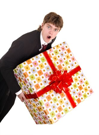 Man with big gift box. Isolated. photo
