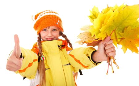 Girl in autumn orange  hat with  leaf group thumb up.  Isolated. photo