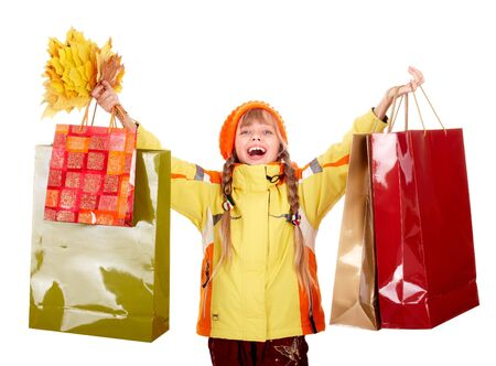 Girl in autumn orange  hat with  leaf group, shopping bag.  Isolated. Stock Photo - 5695068