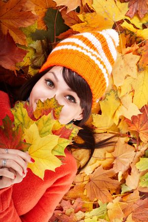 Girl in autumn orange hat on leaf group. Outdoor. Stock Photo - 5696003