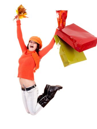 Girl in autumn orange sweater with leaf, shopping bag jump. Isolated. Stock Photo - 5695092