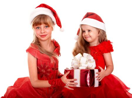 santa clause hat: Group child in santa clause hat with christmas red gift box. Isolated. Stock Photo