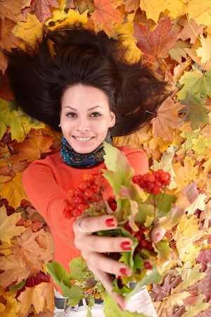 Girl in autumn orange  leaf group with berry. Outdoor. Stock Photo - 5722817