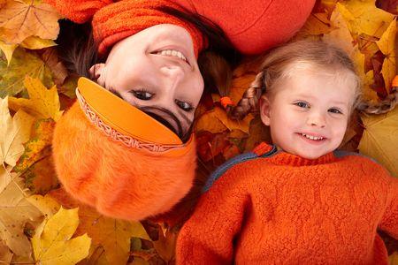 Happy family with child on autumn orange leaf. Outdoor. Stock Photo - 5722837