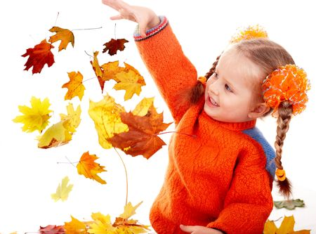 Girl child in autumn orange leaves.Fall discount. Isolated. photo
