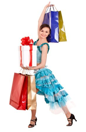 Girl in ball dance dress with gift box, shop bag. Isolated. photo