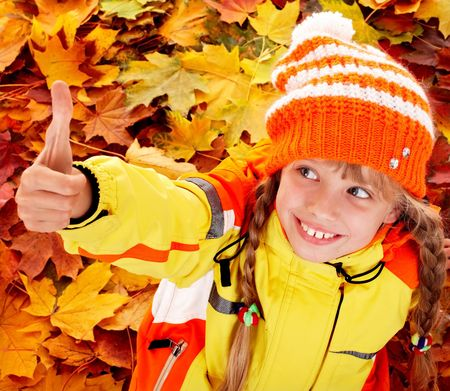 Girl in autumn orange hat with thumb up.  Outdoor. Stock Photo - 5775304