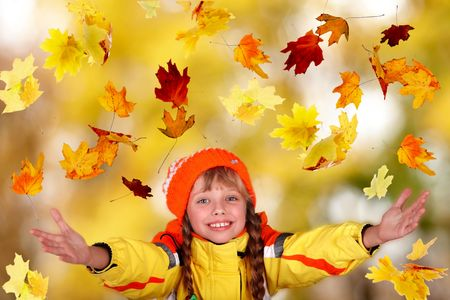 Girl child in autumn orange hat with outstretched arm.  Outdoor. Stock Photo - 5775266