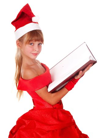 Girl child in red santa hat and book.  Isolated. photo