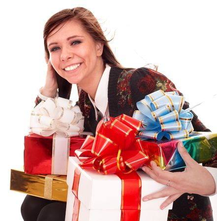 Beautiful girl with group of gift box. Isolated. photo