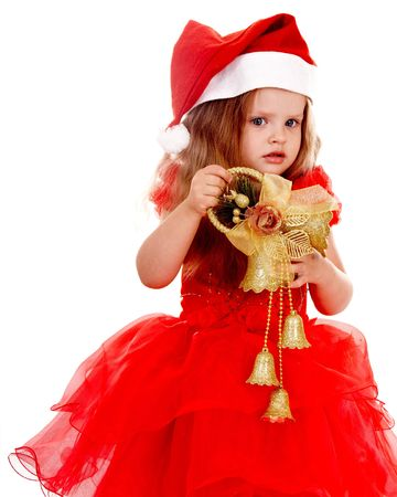 Child girl in red santa hat with christmas bell.  Isolated. photo