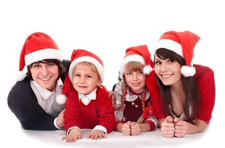 Happy family with children in santa hat. Isolated. photo