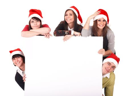 Happy group  people  in santa hat whith banner. Isolated. Stock Photo - 5851474