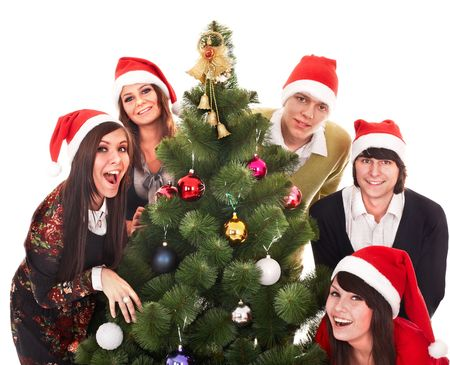 Happy group  people  in santa hat with christmas tree. Isolated. photo