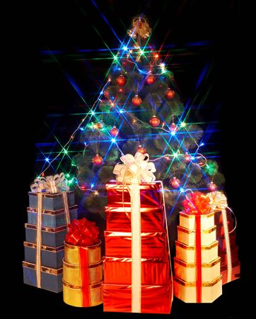 Christmas tree with flash and group gift box. Black background. photo