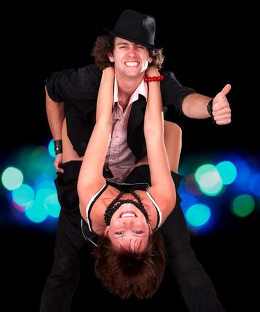 Sport dance couple girl and man with thumb up. Light  background.  photo