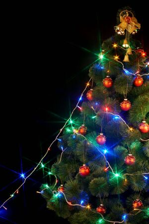 Christmas  tree with light and flash. Black background. photo