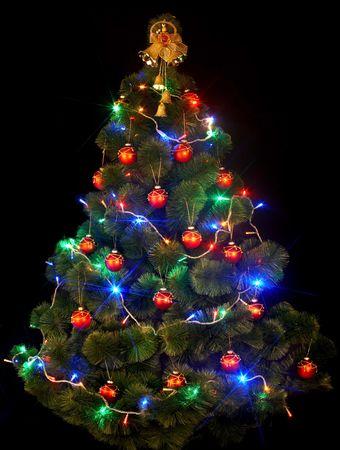 Christmas tree with led light on black background. photo