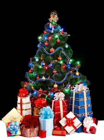 Christmas tree with light and group gift box. Black background. photo