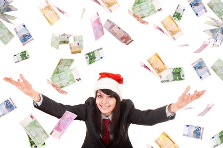 Business woman in santa hat with flying money. Isolated. photo