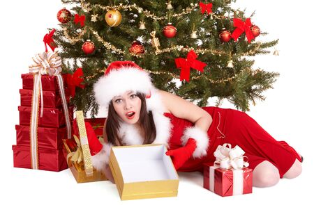 Christmas girl in santa hat and fir tree with empty gift box group. Isolated. photo
