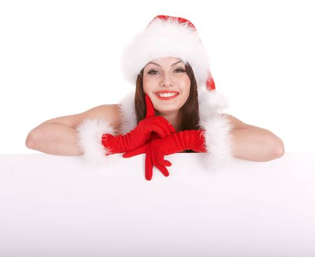 Christmas girl in santa hat with banner. Isolated. photo