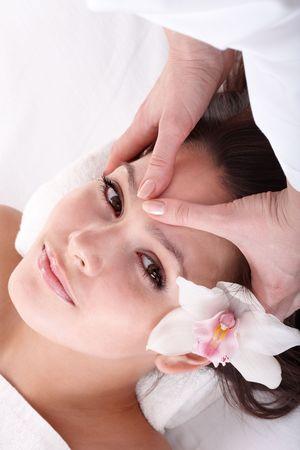 Beautiful young girl and beautician. Facial massage. photo