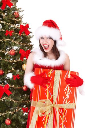 Christmas girl in santa hat and fir tree with red gift box. Isolated. photo