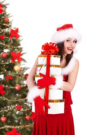 Christmas girl in santa hat and fir tree with group red gift box. Isolated. photo