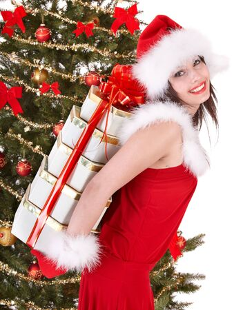 Christmas girl in santa hat and fir tree with red gift box. Isolated. Stock Photo - 6078661