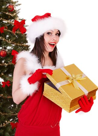 Christmas girl in santa hat and fir tree with gold  gift box. Isolated. photo