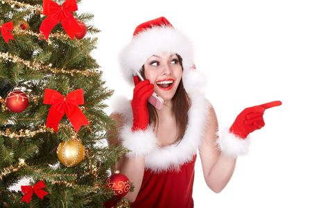 Christmas girl in santa hat call mobile phone, fir tree. Isolated. photo