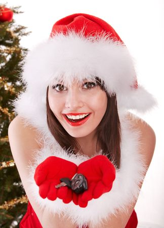 Christmas girl in santa hat with fir tree. Isolated. photo