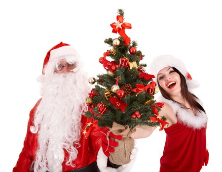 Santa clause  and christmas girl with tree. Isolated. photo
